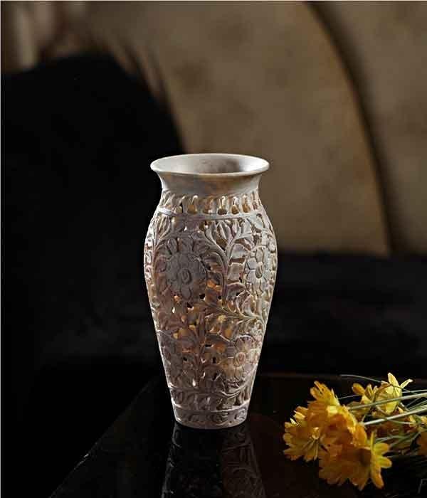 DI- Skillfully carved floral vase  .