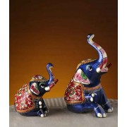 DI- Seated Royal Elephants Set in Enamelled Metal .