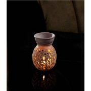 DI- Round carved stone Oil burner  .